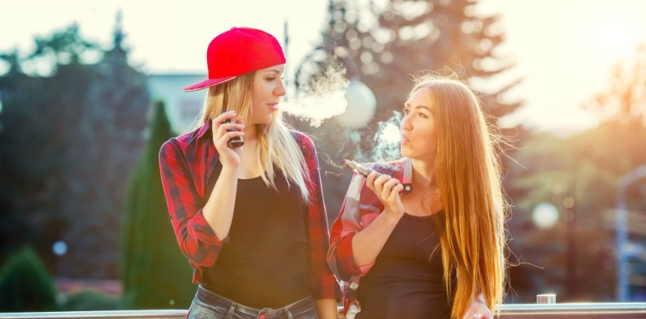 2 Girls using E-cigarettes