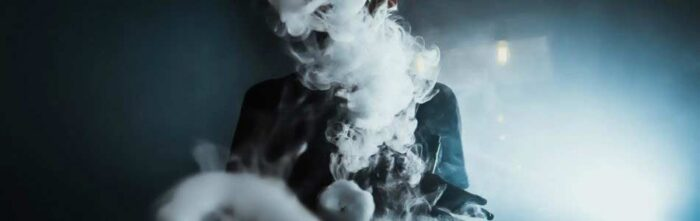 man obscured by ecig vapour
