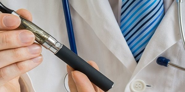 Doctor holding e-cig