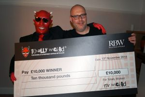 Mr wicked delivering a cheque