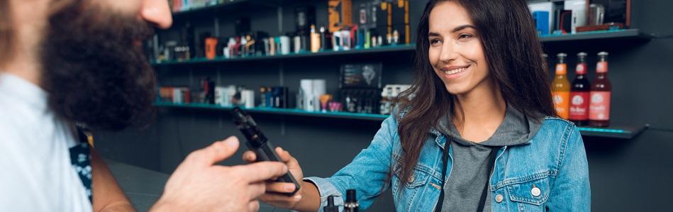 vape shop employee with customer