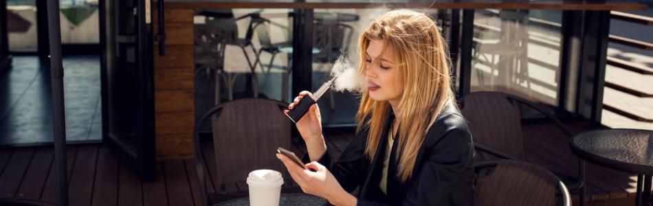 Woman at vaping cafe