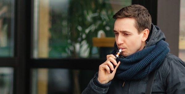 man vaping in street