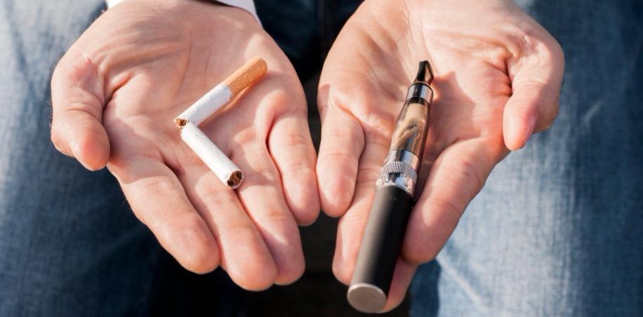 E-cigarette and broken cigarette