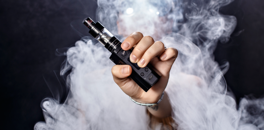 E-cig in hand with vapour