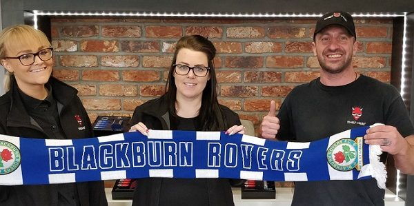 TW staff holding rovers scarf