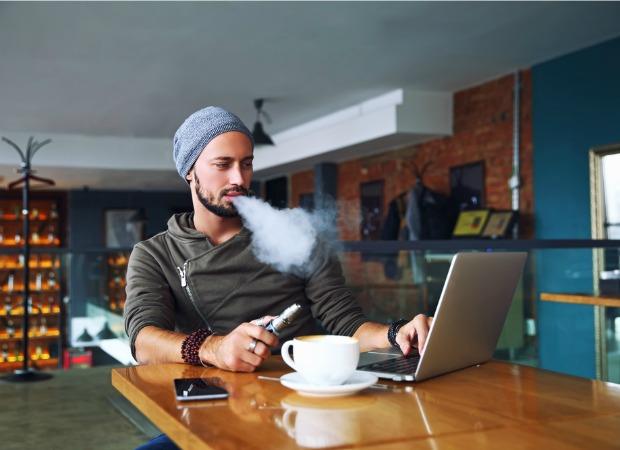 Man vaping at cafe