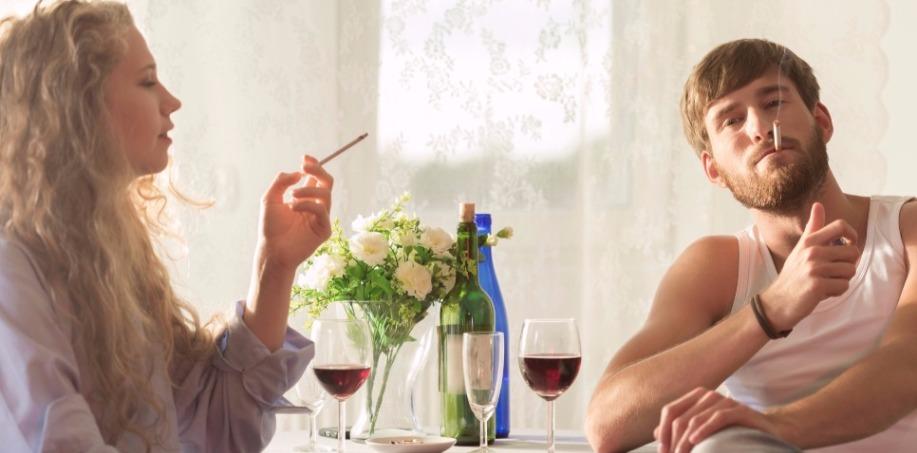 Couple Smoking Sat at Table