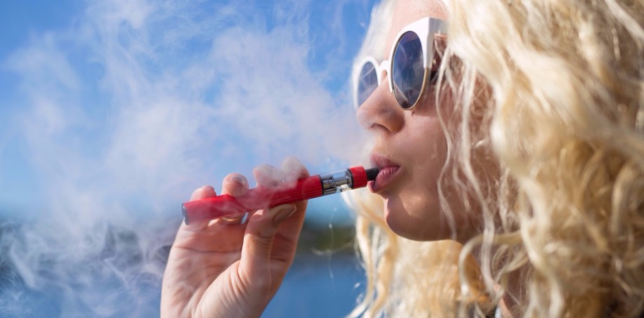 Girl using E-Cigarette