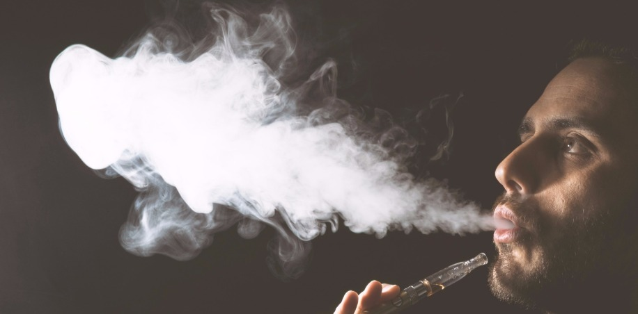 Man Blowing Vape Cloud