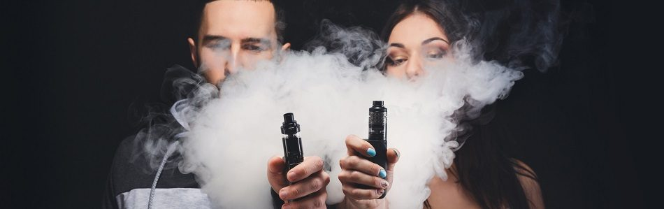 two vapers with e-cigarettes