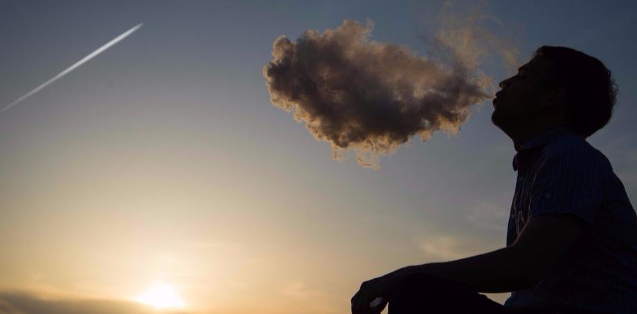 Man exhales large Vape cloud